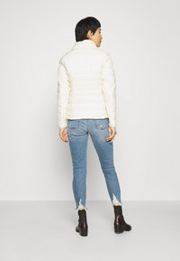 Abercrombie & Fitch - PACKABLE PUFFER POLY - Light jacket - white - 3