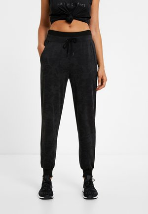 CARRY STYLES - Tracksuit bottoms - black