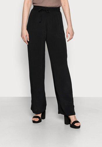 MIKALI - Trousers - black