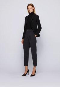 BOSS - TAPIA - Trousers - black - 1