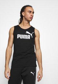 Puma - EVOSTRIPE PANTS - Pantalon de survêtement - black - 3