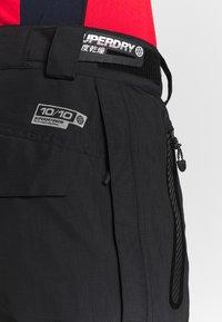 Superdry - PRO RACER RESCUE PANT - Spodnie narciarskie - onyx black - 3