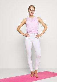 Nike Performance - DRY TANK YOGA - Sportshirt - light arctic pink - 1