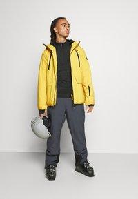 Brunotti - BORAN MENS SNOWJACKET - Snowboardová bunda - cyber yellow - 1