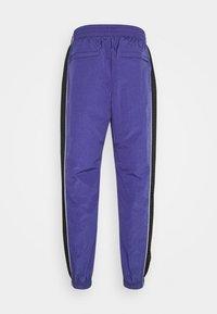 Grimey - UBIQUITY TRACK PANTS UNISEX - Tracksuit bottoms - purple - 1