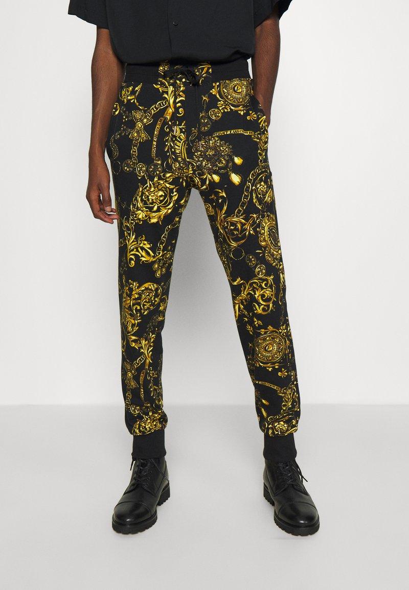 Versace Jeans Couture - PRINT REGALIA BAROQUE - Tracksuit bottoms - nero/oro