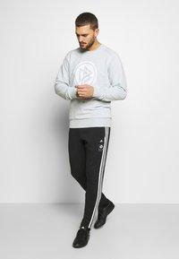 adidas Performance - DEUTSCHLAND DFB ICONS PANT - National team wear - black - 1