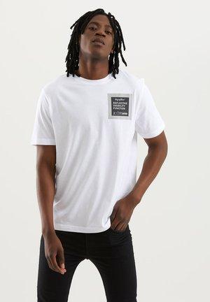 HV REFLEX - Print T-shirt - bianco ottico