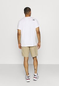 The North Face - PARAMOUNT ACTIVE - Träningsshorts - beige - 2