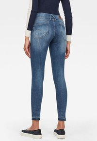 G-Star - LYNN MID SKINNY RIPPED ANKLE - Jeans Skinny Fit - blue denim
