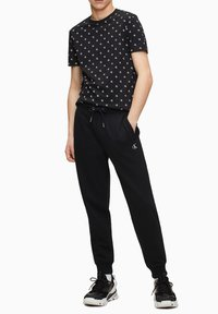 Calvin Klein Jeans - Tracksuit bottoms - ck black - 1