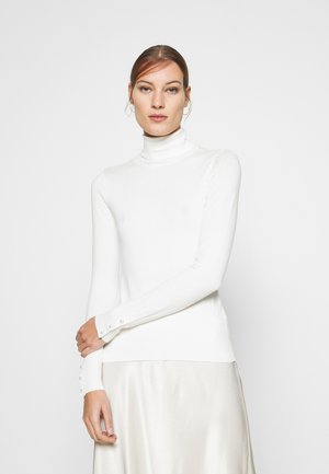 PEARL BUTTON CUFF ROLL NECK JUMPER - Jumper - ivory