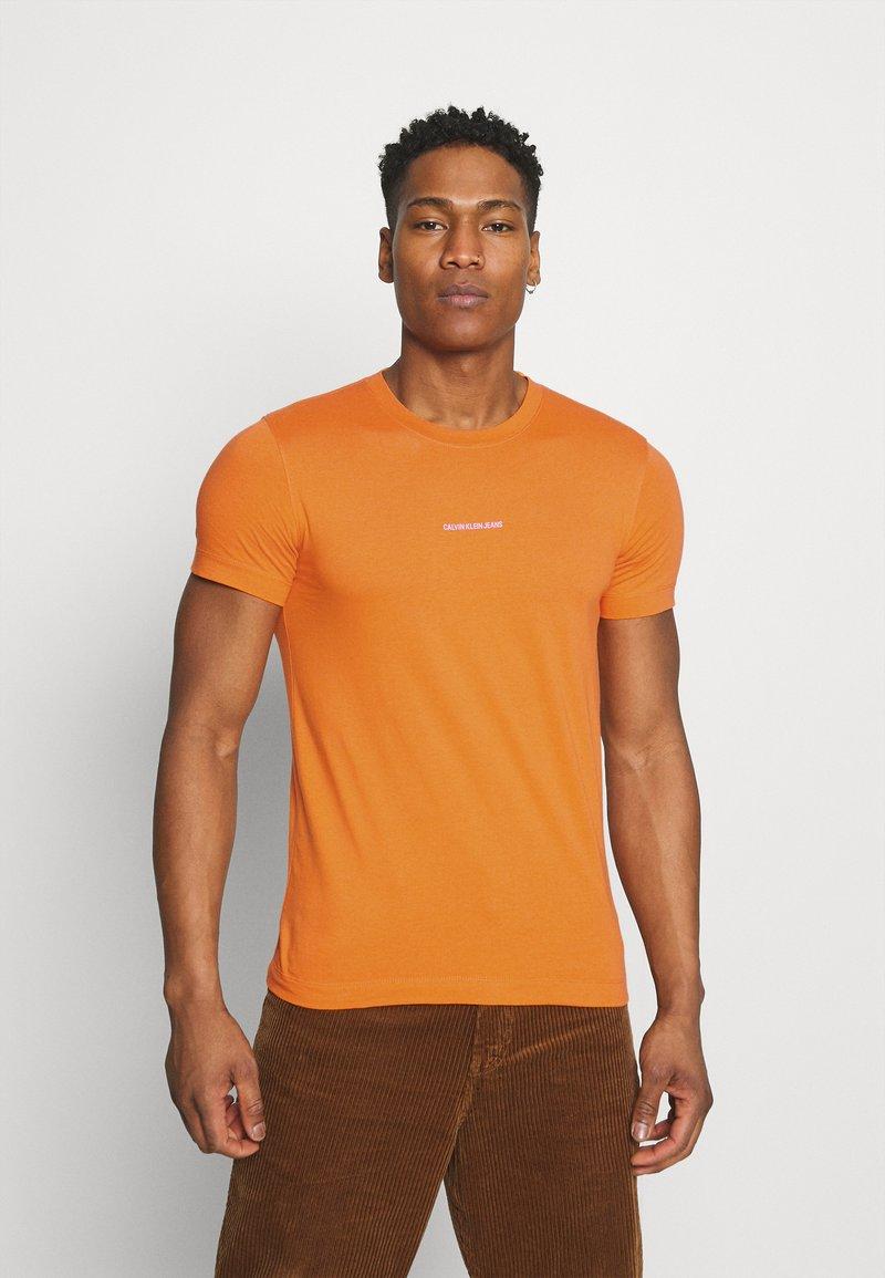 Calvin Klein Jeans - MICRO BRANDING ESSENTIAL TEE - Basic T-shirt - rusty orange