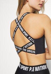 P.E Nation - RACING LINE SPORTS BRA - Medium support sports bra - black - 5