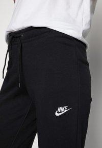 Nike Sportswear - TIGHT - Pantalon de survêtement - black/white - 4