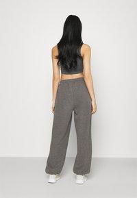 NA-KD - NA-KD X ZALANDO EXCLUSIVE - LOOSE FIT PANTS - Tracksuit bottoms - dark grey - 2