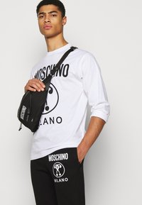 MOSCHINO - TROUSERS - Tracksuit bottoms - black - 3
