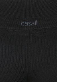 Casall - SEAMLESS SLIT PANTS - Tracksuit bottoms - black - 2