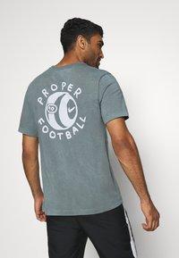 Nike Performance - FC TEE SEASONAL - Print T-shirt - smoke grey - 2