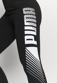 Puma - GRAPHIC LEGGINGS - Collants - black - 3
