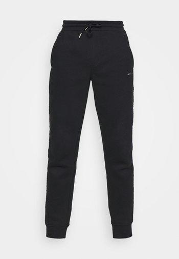 LOGO - Pantalones deportivos - black