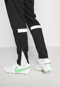 Nike Performance - ACADEMY 21 PANT - Tracksuit bottoms - black/white - 5
