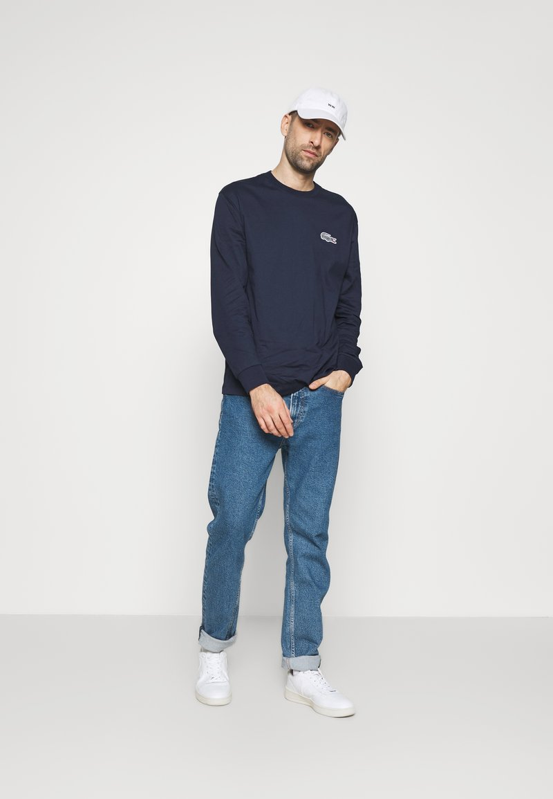 Lacoste - LACOSTE X NATIONAL GEOGRAPHIC - Long sleeved top - navy blue/zebra