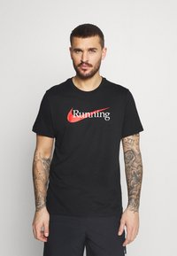 Nike Performance - TEE - T-shirts med print - black - 0
