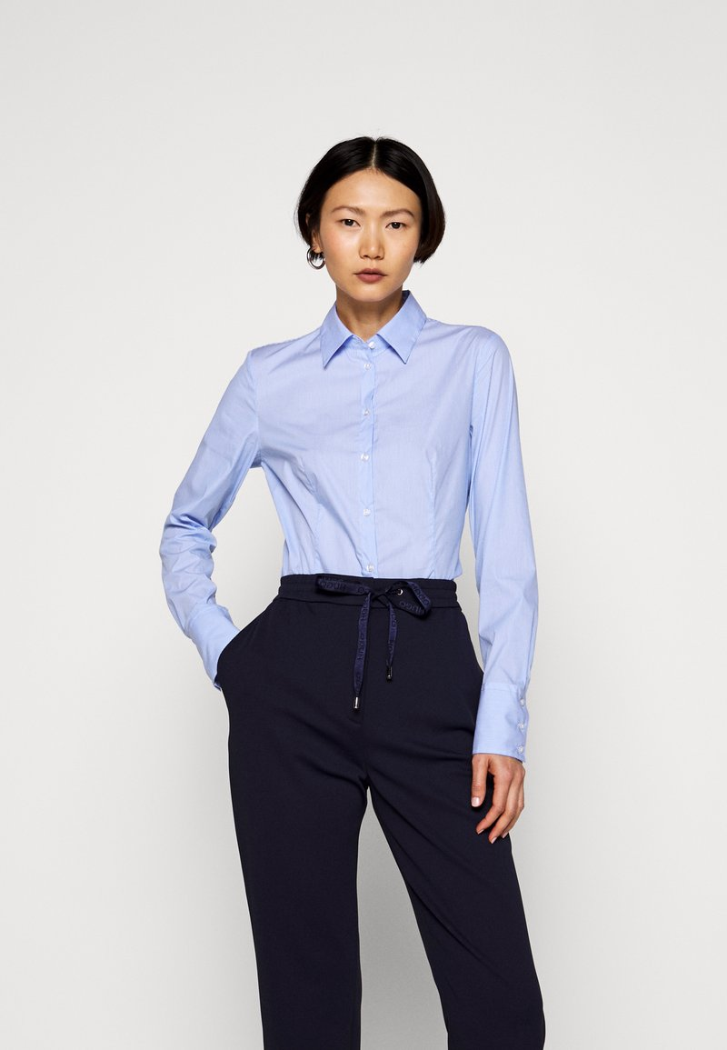 HUGO - THE FITTED - Button-down blouse - blue