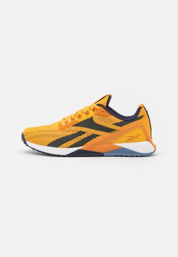 NANO X1 LES MILLS FLOATRIDE ENERGY FOAM TRAINING WORKOUT - Sports shoes - semi solar gold/radiant ochre/vector navy