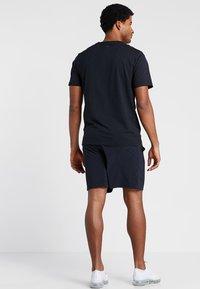 Calvin Klein Performance - SHORT - Sports shorts - black - 2