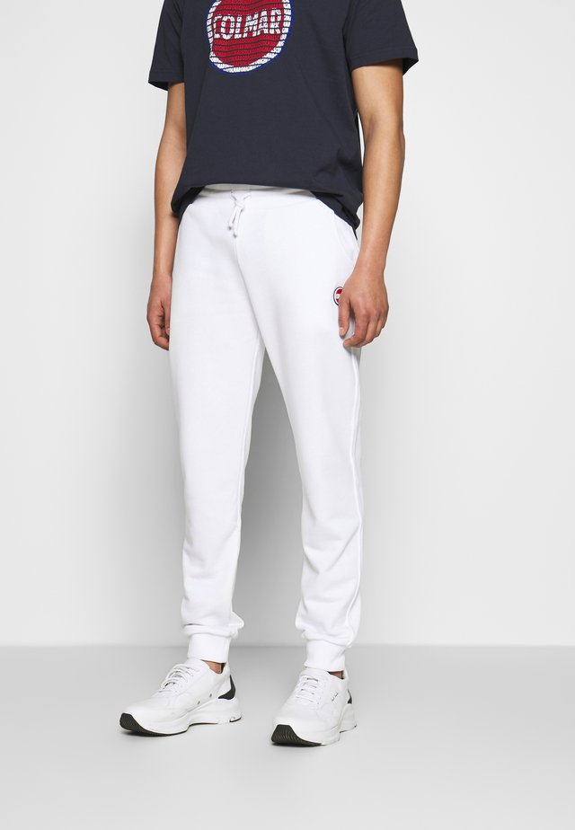MENS PANTS - Verryttelyhousut - white