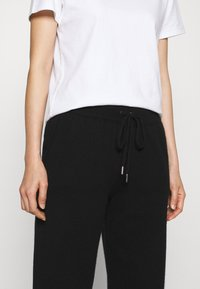 Johnstons of Elgin - CUFFED JOGGERS - Tracksuit bottoms - black - 4