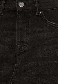ONLY Petite - ONLSKY SKIRT RAW EDGE - Spódnica jeansowa - black - 2