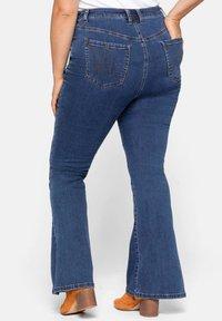 Sheego - Bootcut jeans - blue denim - 2