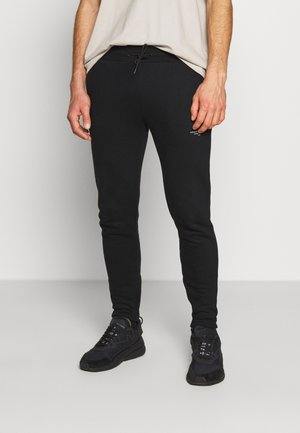 ESSENTIAL - Tracksuit bottoms - black