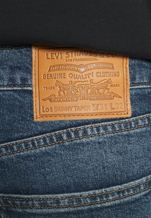Levi's® SKINNY TAPER - Jeansy Skinny Fit - dark indigo/niebieski denim Odzież Męska EDCT