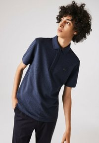 Lacoste - Polo shirt - bleu chine - 0