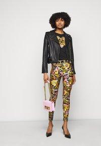 Versace Jeans Couture - LADY FUSEAUX - Legíny - black - 1