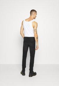 Redefined Rebel - STOCKHOLM DESTROY - Slim fit -farkut - edgy black - 2