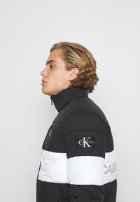 Calvin Klein Jeans - OUTLINE LOGO JACKET - Winter jacket - black - 3