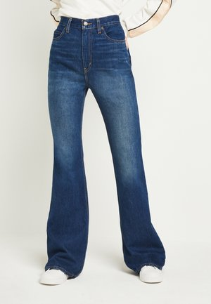 70S HIGH FLARE - Jean flare - standing steady