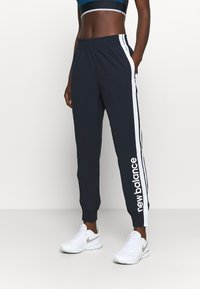 New Balance - ACHIEVER - Tracksuit bottoms - eclipse - 0