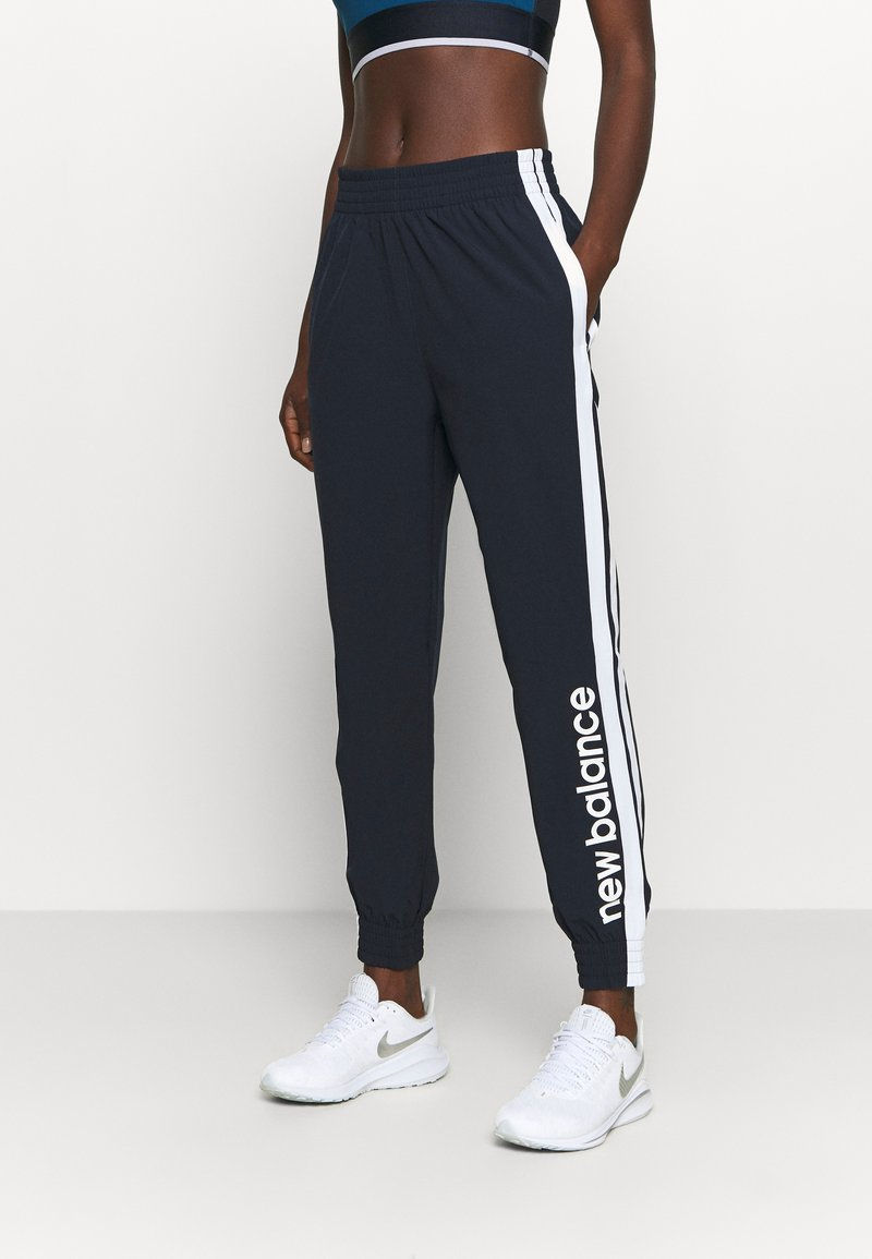 New Balance - ACHIEVER - Tracksuit bottoms - eclipse