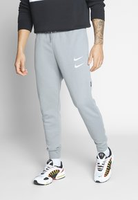 Nike Sportswear - M NSW PANT FT - Verryttelyhousut - particle grey - 0