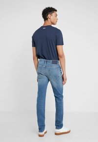 BOSS - TABER - Jeans Tapered Fit - bright blue - 2