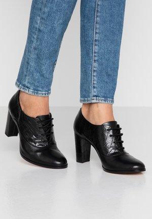 KAYLIN IDA - Ankle boots - black