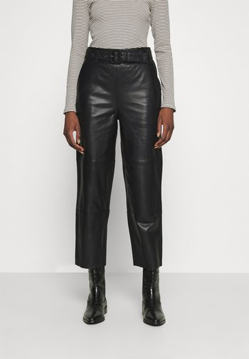 STORIA PANTS - Leather trousers - black