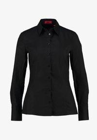 HUGO - ETRIXE - Button-down blouse - black - 5