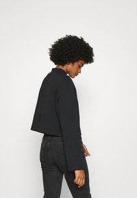 Tommy Jeans - SOLID HYBRID LONGSLEEVE - Bluzka z długim rękawem - black - 2